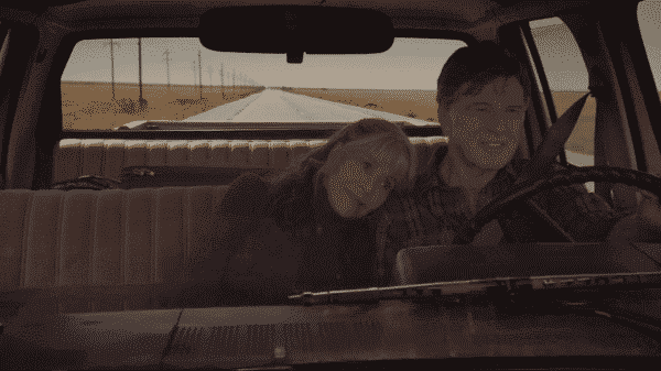 Addie laying on Louis' shoulder as he drives them both home.