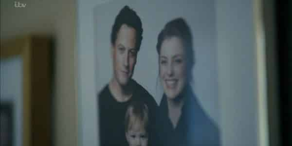A picture of Andrew, his wife Mary, and their son.
