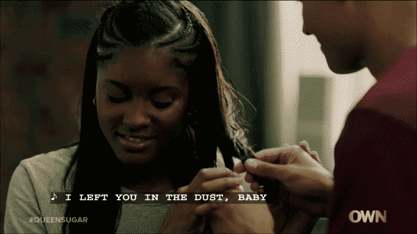 Keke teaching Micah how to braid her hair.