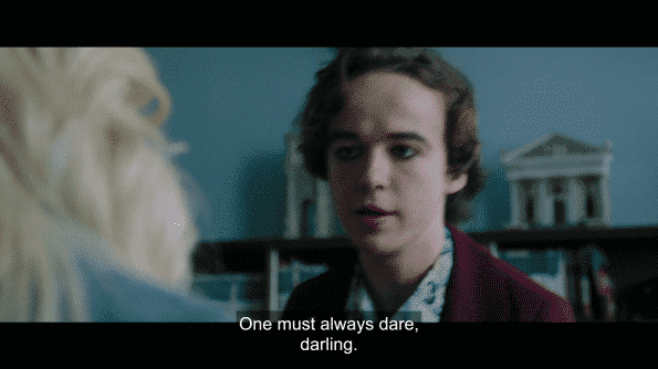 "Alex Lawther as Billy saying ""One must always dare, darling."""