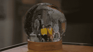 Schneider's snow globe featuring him and Lydia's family.