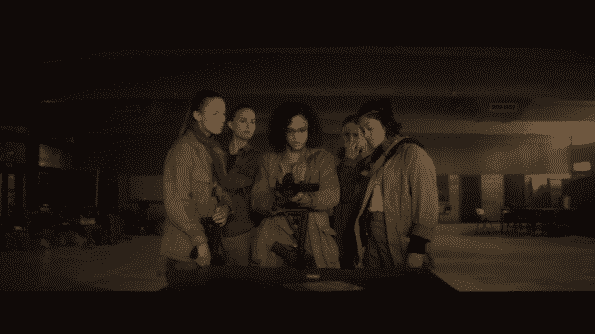 An image with, from left to right, Tuva Novotny, Natalie Portman, Tessa Thompson, Jennifer Jason Leigh, and Gina Rodriguez all looking at a video camera.