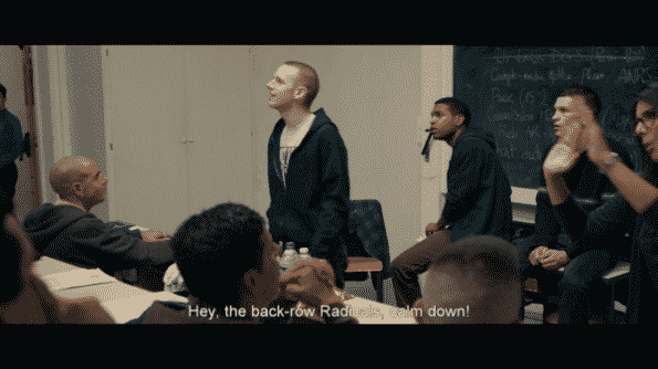 Antoine Reinartz as Thibault in BPM (Beats Per Minute) shouting at the radicals, including Sean, to calm down.