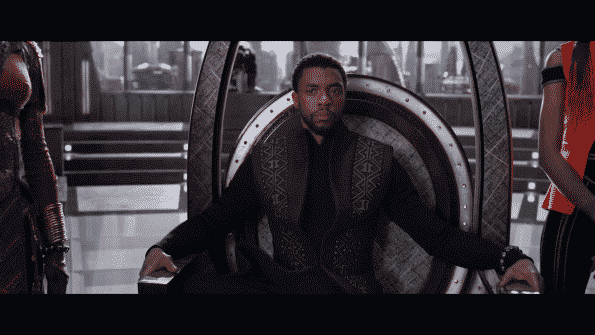 T'Challa sitting on his throne, within the council.
