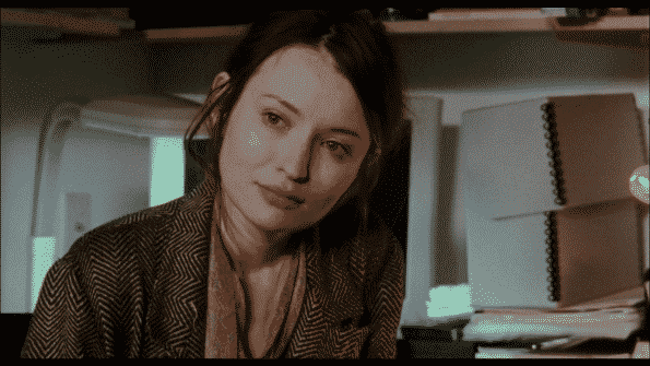 Emily Browning as Naomi, looking over at Nick.