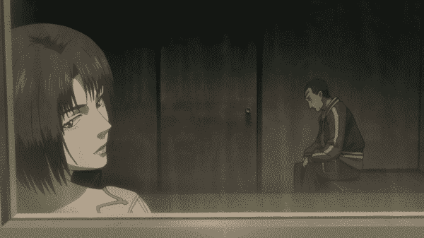 Majima looking out of the window as Sako looks towards the floor.