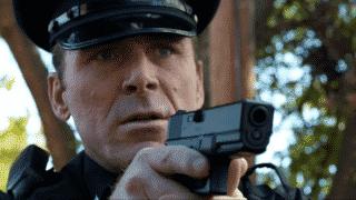 A cop pointing their gun at Eva.