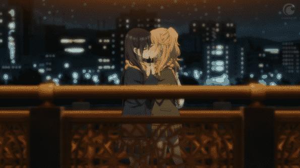 Yuzu and Mei kissing on a bridge.