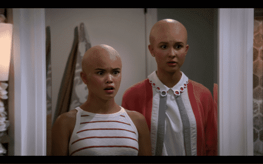 Alexa and Katie after shaving their heads bald.