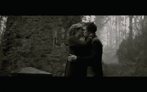 Mary and Percy kissing.