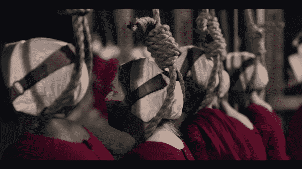 Handmaids with ropes around their neck.