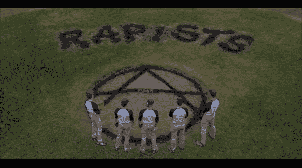 "The baseball field with ""RAPIST"" in large letters and a anarchy symbol."