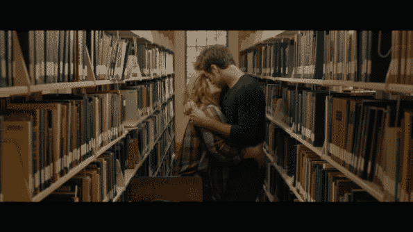 Deanna and Jack making out in the library.