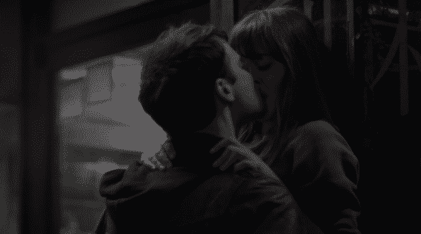 Jake and Tess, passionately, kissing.