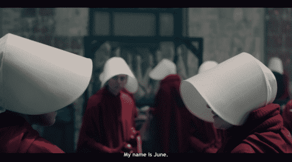 June properly introducing herself to other handmaids.