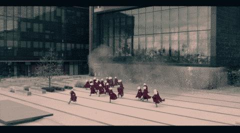 Handmaids running after a terrorist attack.