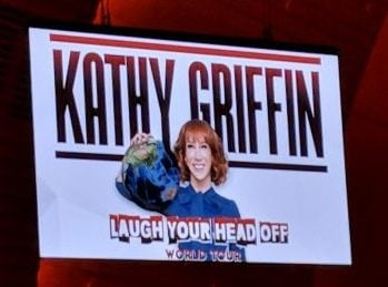 "Screen showing advertisement for Kathy Griffins ""Laugh Your Head Off"" world tour."