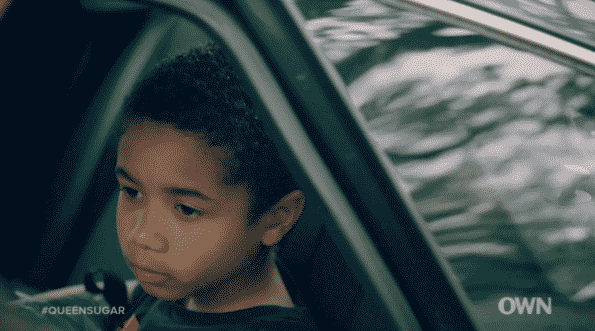 Blue in the car, slowly realizing his parents may not end up together.