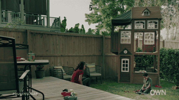 Darla and Blue talking in her backyard.