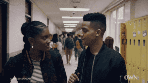 Keke and Micah walking down the hall together.