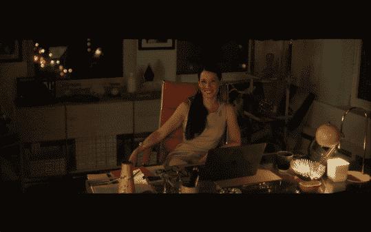 Kirsten sitting at her desk smiling.