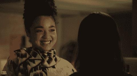 Kat smiling at Adena.