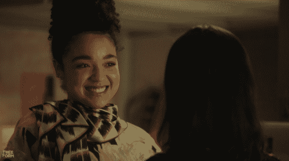 Kat smiling at Adena.