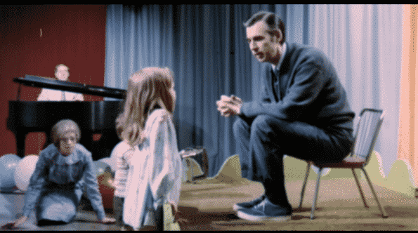 Fred Rogers speaking to a child.