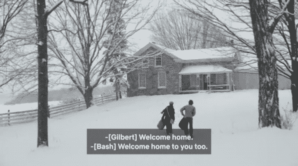 Gilbert and Sebastian walking up to Gilbert's house in the snow.