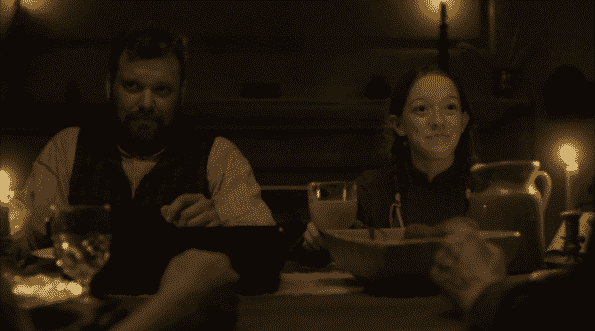 Mr. Dunlop and Anne during dinner.