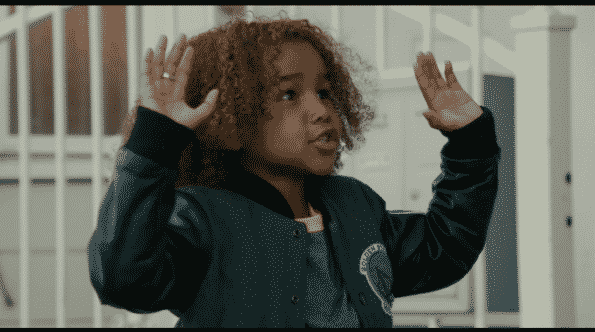 """Sean, Miles and Ashley's son, with his arms raised up saying, """"Don't shoot!"""""""