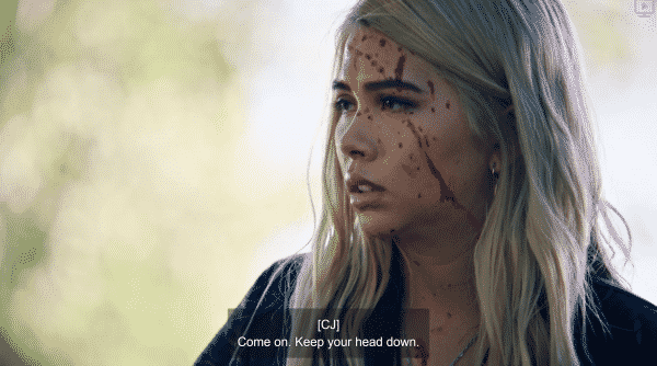 Lexi's face, covered in blood, after Eric shot himself.