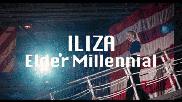 Iliza walking down with the title card overlayed