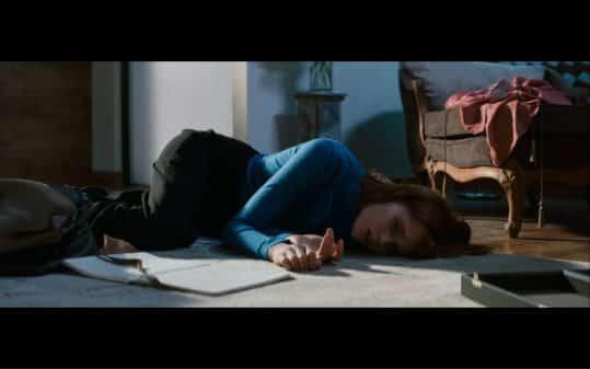 Elizabeth laying on the floor.