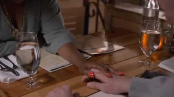 Megan touching Doug's hand.