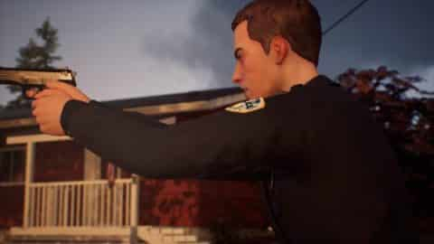 An officer pointing his gun towards Sean and Daniel.