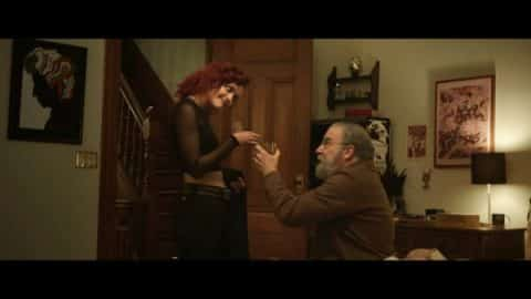 Olivia Cooke as the older Dylan with Mandy Patinkin who plays Irwin.
