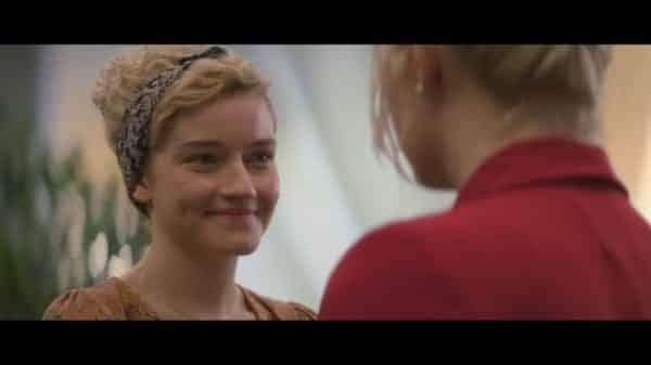 Ellie smiling at Annie.