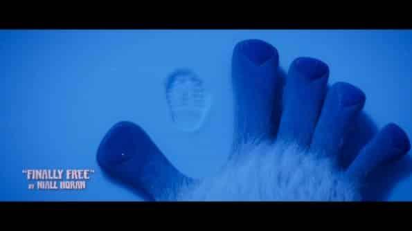 Migo comparing his hand to a human foot print.