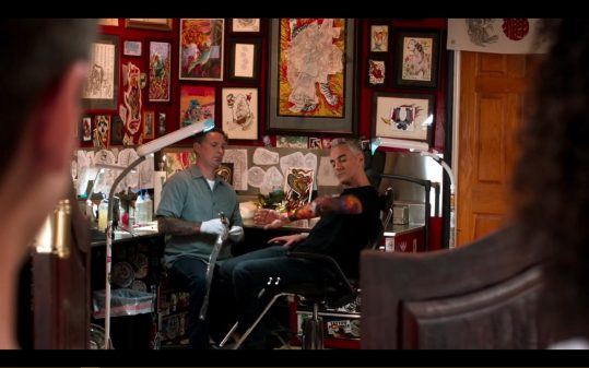 Dr. Metcalf getting a tattoo.