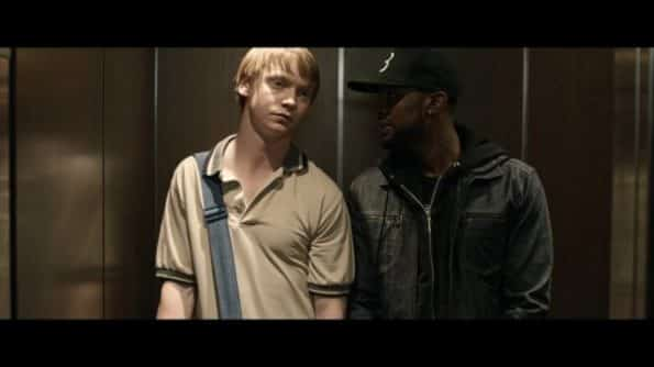 Adam (Calum Worthy) and Behn (Jackie Long) in a elevator.