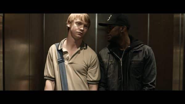 Prospek (Jonathan Park) and Adam (Calum Worthy) during a rap battle.