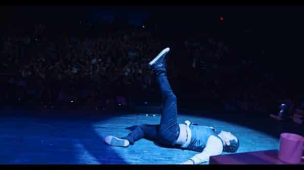 John Leguizamo on the floor, after dancing.