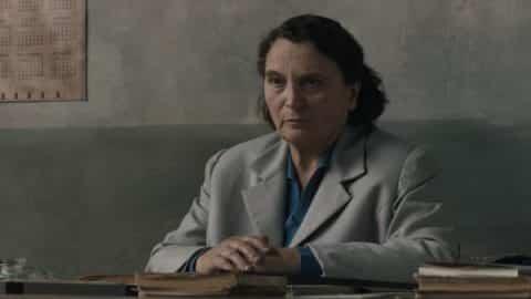 Maestra Oliviero (Dora Romano) looking at her classroom.