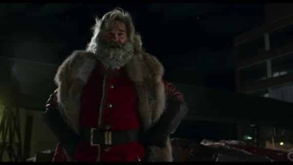 Santa (Kurt Russell) doing a Wonder Woman pose.