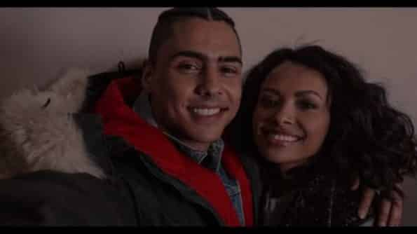 Josh (Quincy Brown) and Abby (Kat Graham) taking a picture together.
