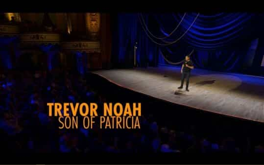 Trevor Noah stepping out on stage.