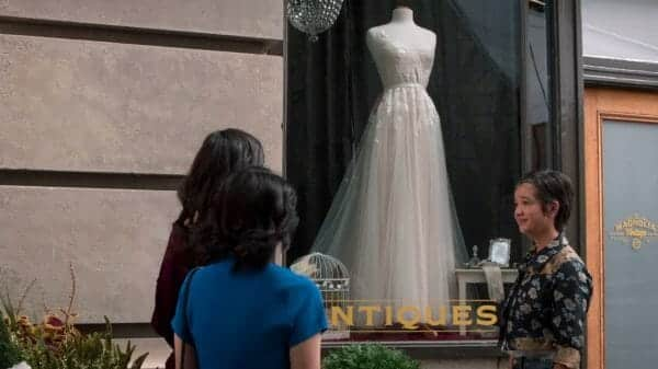 Andi pointing out a dress she'd think would be perfect for Bex.