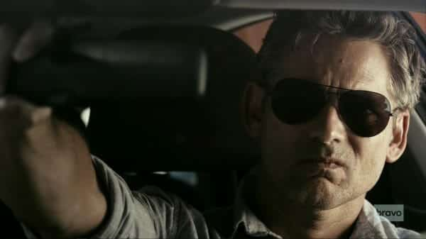 John adjusting his rear-view mirror.