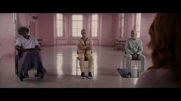 Elijah (Samuel L. Jackson), Kevin (James McAvoy), and David (Bruce Willis) sitting in a room together.